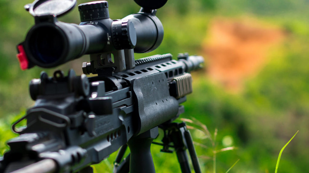 image of the sound of assault rifle gun sitting on grass
