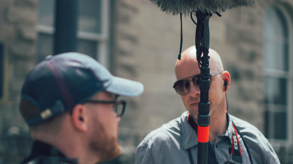 image of sound guy on set, focused on what he can do to record good sound