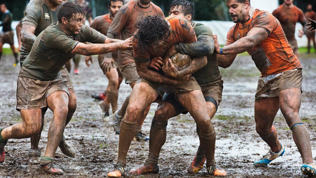 image of the sound of rugby players fighting over ball on a muddy field