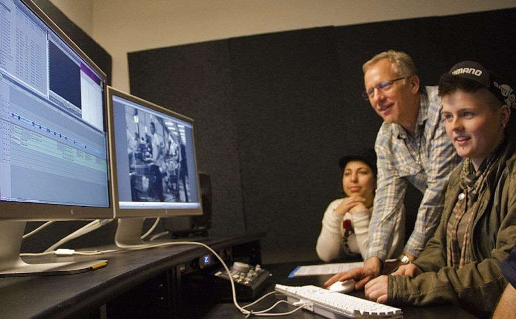 image of video student learning how to make a video editing demo reel