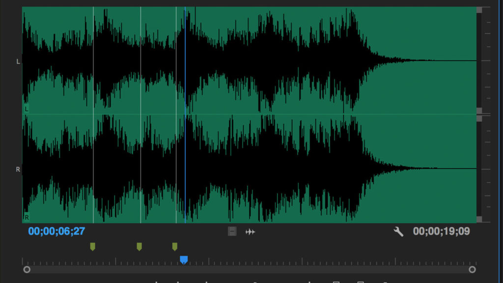 screenshot of audio waveform in Premiere Pro with edit point markers to save time