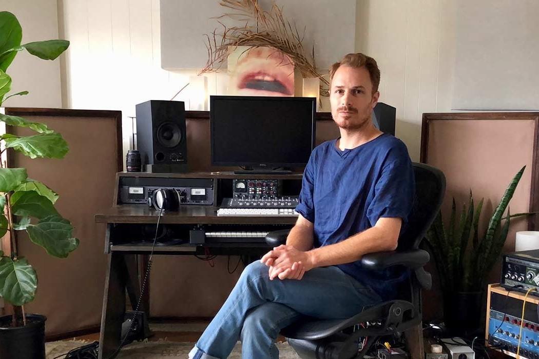 photo of blake henderson in his studio