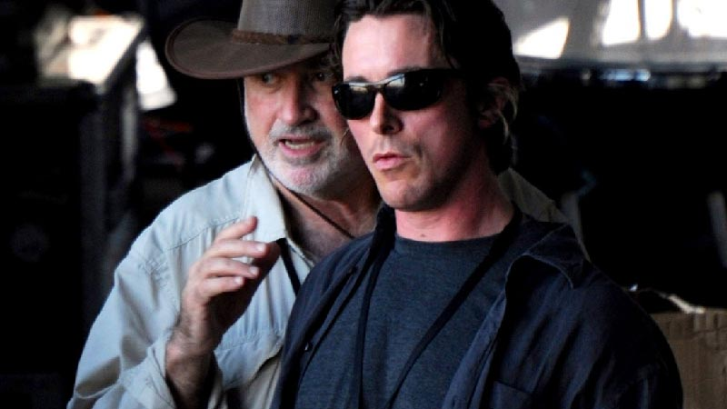 photo of terrence malick with christian bale on set